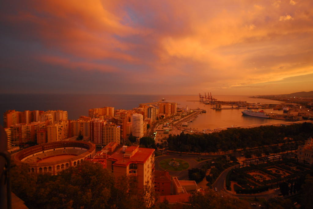 The sea-side city of Malaga awash with brilliant colours as the sun sets